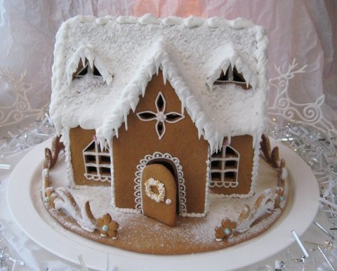 Snow covered  Gingerbread with icicles excited for the holidays!