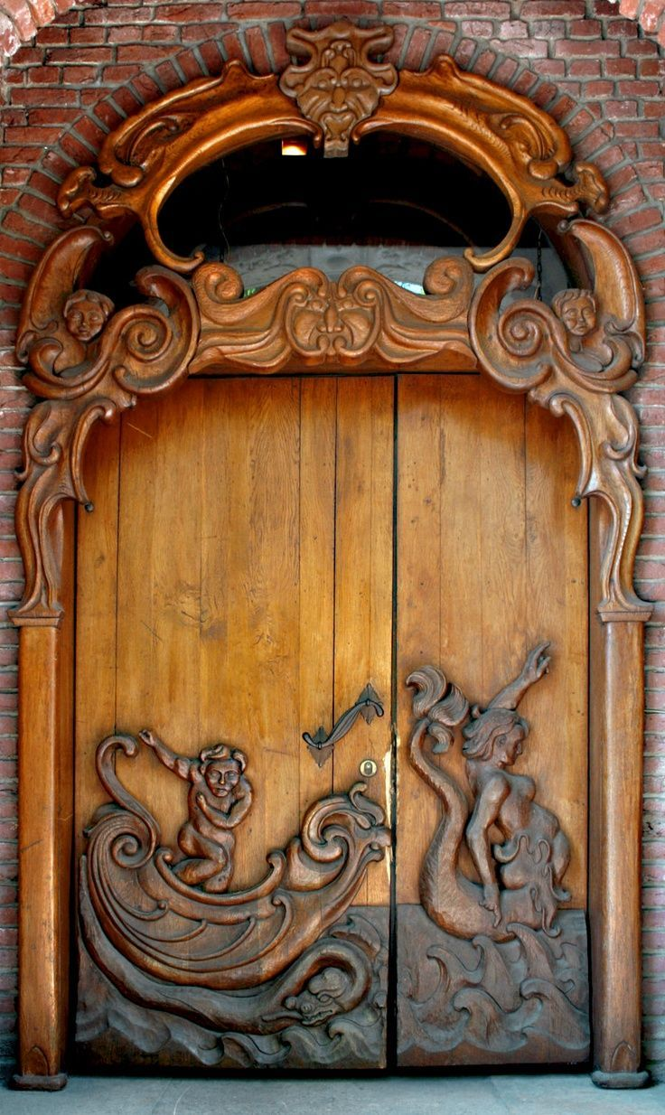 The mermaid and sailor motif in an Art Nouveau carved wood door