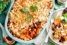 Rigatoni pasta bake with garlic bread topping - Get into this easy vegetarian pasta bake that cleverly uses store-bought garlic bread as the crunchy topping.