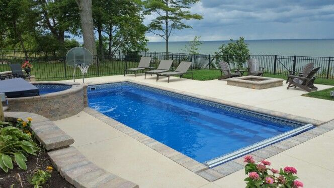 Leisure Reflection fiberglass pool with round spillover spa and autocover