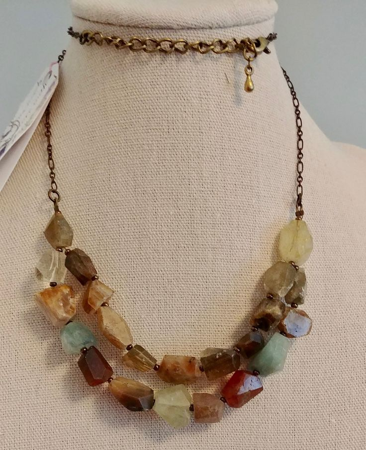 Mixed faceted Semi-Precious Stone nuggets on a bronze tone chain, detail.