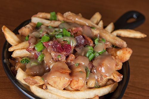 Chant with us: Poutine! Poutine! Poutine! (This particular poutine is from Harriet's Inn. Order now with Bite Squad!)