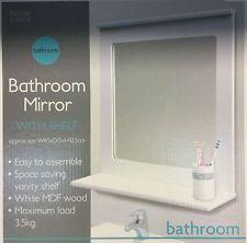 The Art Gallery Framed bathroom mirror with shelf