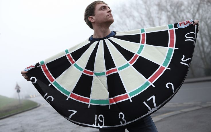 A fan poses dressed as a darts board outside Alexandra Palace ahead of the quarter finals of the 2016 World Darts Championship.