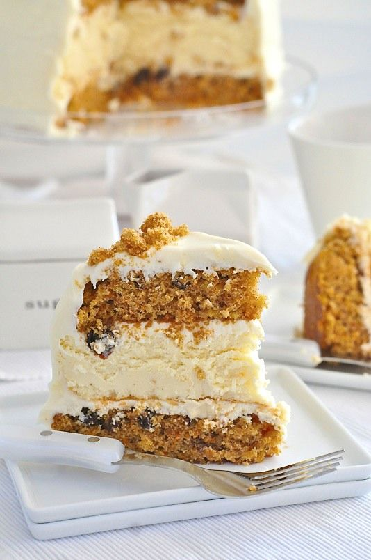 Creamy Cheesecake between two layers of Carrot Cake