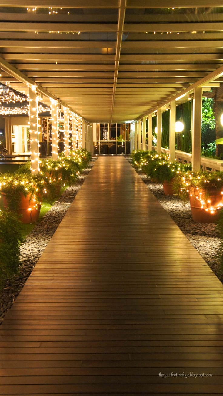 do the walk way and gravel with lit planters to a screened detached gazebo