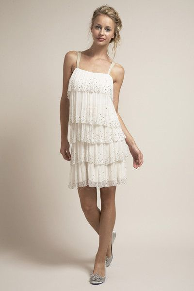 This short above the knee beaded flapper dress is for a bride who wants to dance the night away. The ombre hand beaded ruffle details move with the body, adding to the drama of this dress. The dress can also be worn with a cream sash to give more waist definition.  • We also recommend pairing this dress with our cream sash for a more defined waist. Made of 100% silk: • Top layer: Beaded off white silk chiffon • Lining: Cream silk charmeuse. • This dress does not come with a sash. • Should…
