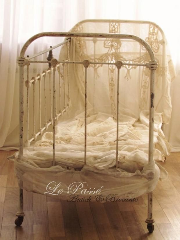 METAL BABY CRIB....I HAVE PHOTOS OF MY HUSBAND AS AN infant in this type of crib.