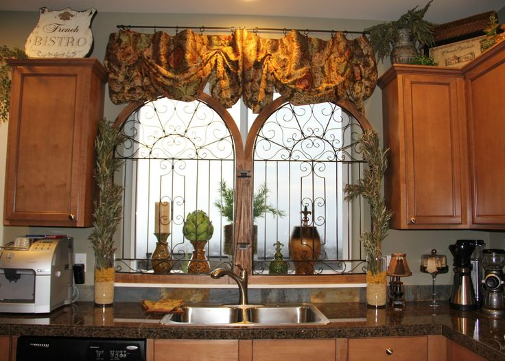 Savvy Seasons by Liz: Welcome to Our Tuscan Kitchen.  I like the iron work in front of the window!!!!