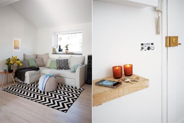 Simpleza, estética y funcionalidad en las alturas de Barcelona  En el rincón del estar: alfombra (Lorena Canals), sofá en 'L' (Ikea) con almohadones estampados (H
