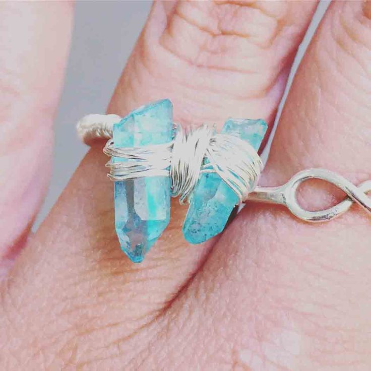 Valencia Ring by Renegade Relics - $25 Story: This ring has a calm, relaxing effect on the emotional body and is exceptional for releasing negativity and stress, soothing and healing the aura. The clear quartz and aqua aura are both great for deepening spiritual attunement, opening gateways to the angelic realm.