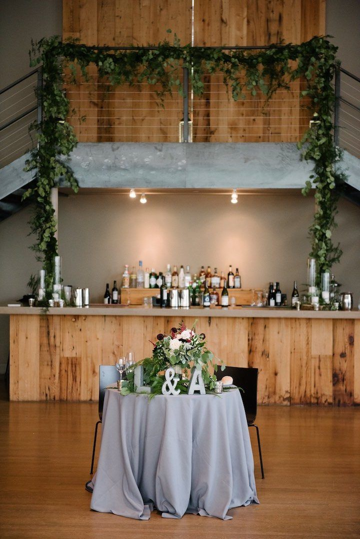 Sweetheart table at the Roundhouse. Staircase greenery at the Roundhouse. Dark + Diamond Floral Design.