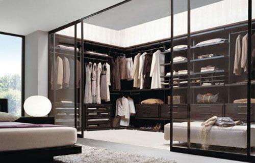 walk in wardrobe/closet behind clear glass sliding doors