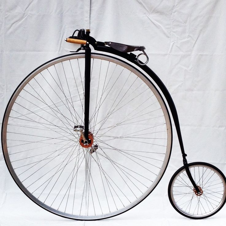 A beautiful Penny Farthing built by Dan Bolwell with copper finish hubs, spoon brake, raw rims and a Gloss Black finish.  www.pennyfarthingdan.com.au