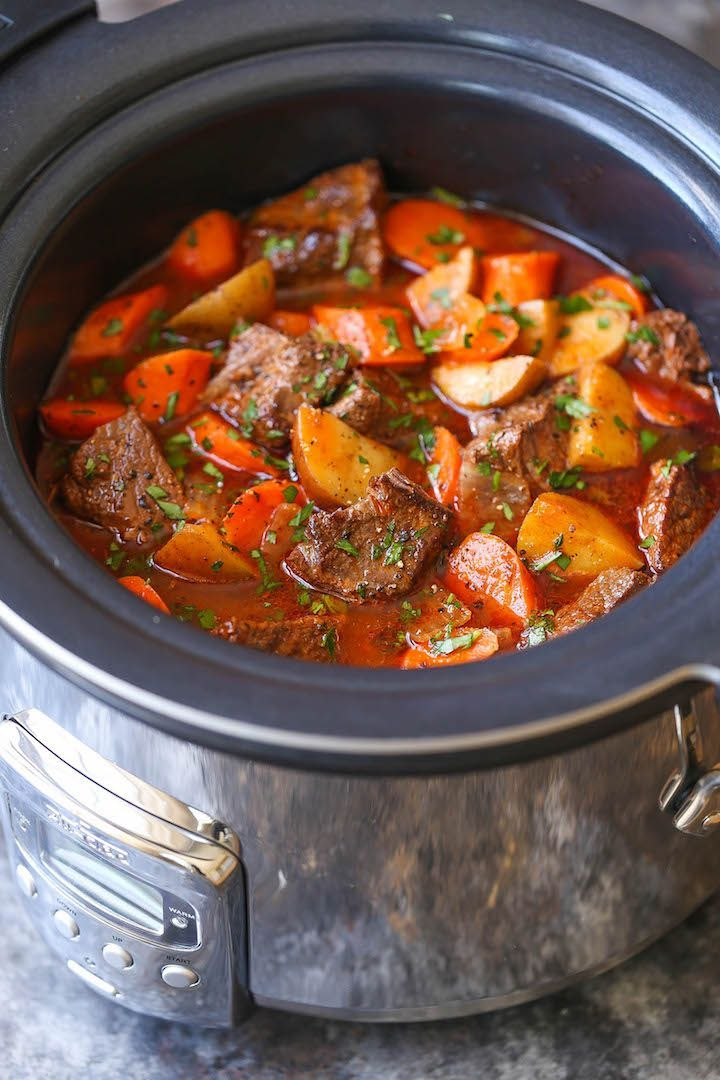 Slow Cooker Beef Stew - Everyone's favorite comforting beef stew made easily in the crockpot! The meat is SO TENDER and the stew is rich, chunky and hearty!