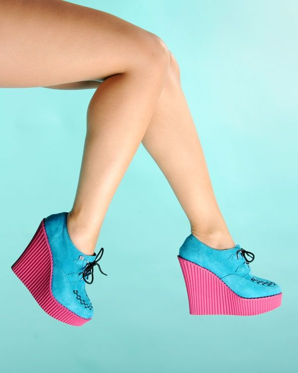 Suede Creeper Wedge in Turquoise with Pink Sole - Creepers reach all new heights with these new Creeper Wedges!   High-grade turquoise suede is soft and rich, and the black interlace front, petite d-ring tabs, and silver metal d-rings help give these wedges the classic creeper look. The pink ridged PU sole is lightweight and the height ranges from about 5 1/4 inches in the back to 1 1/4 inches in the front.