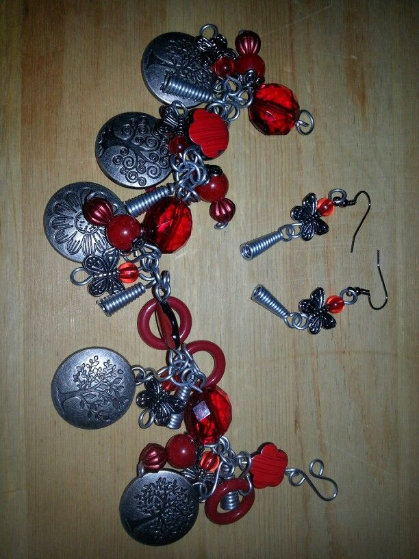 Ruby Red:  Chunky Charm Bracelet and earings handcrafted from 20 guage steel wire,  acrylic beads, wire cones, butterflies,  flower and tree charms, red ring beads