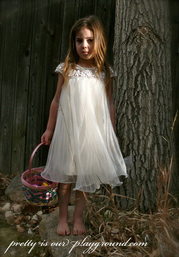 easter egg hunt. little girl in a white dress.  perfect for a flower girl