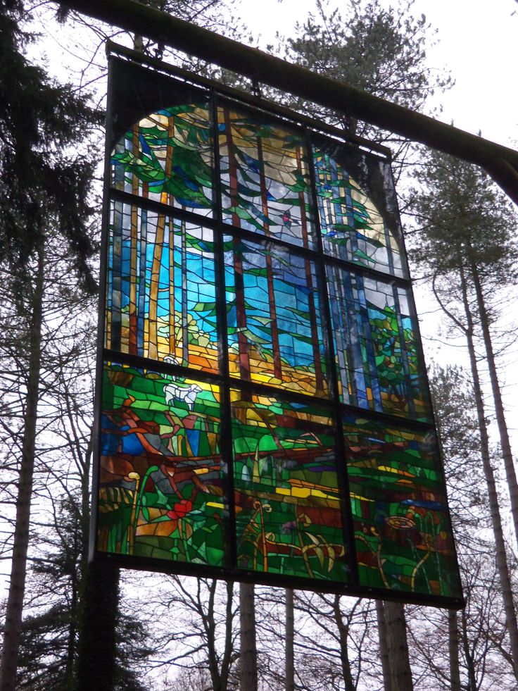 Awesome stained glass window in the middle of the sculpture trail in the Forest of Dean