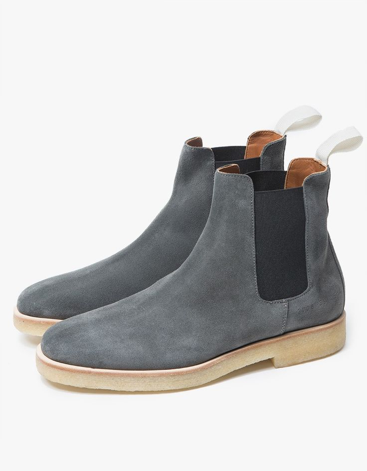 From Woman by Common Projects, a classic Chelsea Boot in Washed Black. Suede upper. Almond toe. Pull-on design. Black elastic goring at ankle. Contrast grosgrain pull tab. Tonal stitching. Subtle stamped serial number at heel. Lined.  • Leather upper •