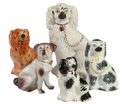 staffordshires... I love these! I have two small black ones on my mantel. Their names are Gog and Maygog like Anne of GreenGables.