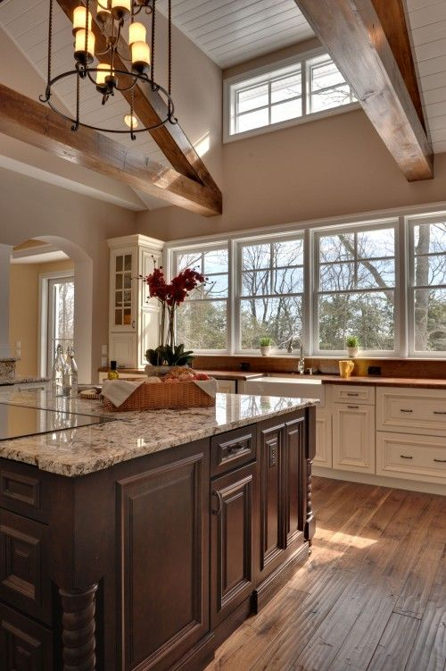 Cream cabinets with dark island !!!! Also LOVE the ceiling beams and upper window   Follow me and i will show you awesome home decor! :)