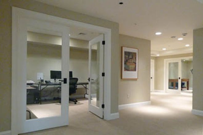 Glass Door To Basement Office To Let Some Light In That Doesn T Even Look Like A Basement Basement Office Basement Home Office Home Gym Design