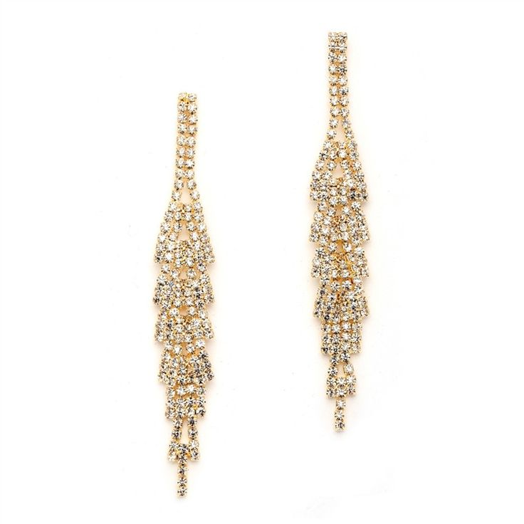 "Classic gold rhinestone dangle earrings are taken to the next level with unique dimensional layers. These cascading golden beauties will add drama to any wedding, prom, or formal attire. 3 1/4"" h."