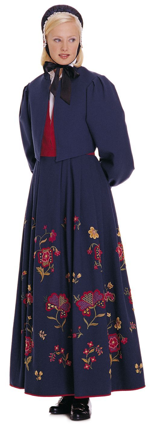 """Kvinnebunad fra Gudbrandsdalen (Womens bunad from Gudbrandsdalen)"" with red damask waist and blue embroidered skirt from Gudbrandsdalen, Oppland, Norway (I think this color is the only option. The model wear a jacket that are made for this bunad)"