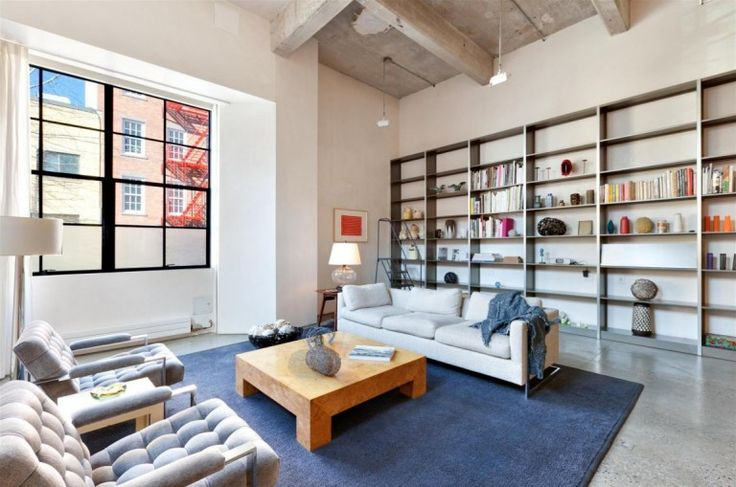 Loft : Two Floor Loft Idea with Three Bedroom in West Village New York City - Loft Living Room Interior in West Village with Tufted Arm Chairs and Beige Sofa and Square Wooden Coffee Table also Blue Area Rug Huge and Bookshelf Unit medium version