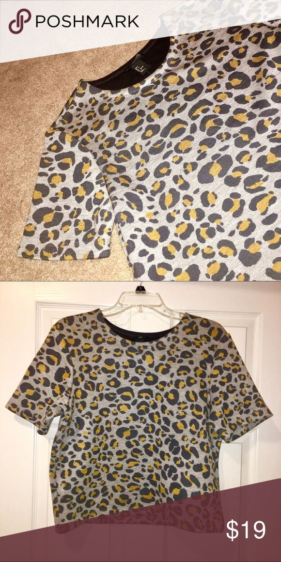Cheetah print shirt Cute short sleeved cheetah print shirt. Thicker material. Great condition H&M Tops