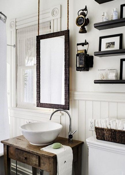 We love this idea of suspending a mirror! (Victorian bathroom remodel featuring mirror hanging on chains by Antonio Martins Interior Design)