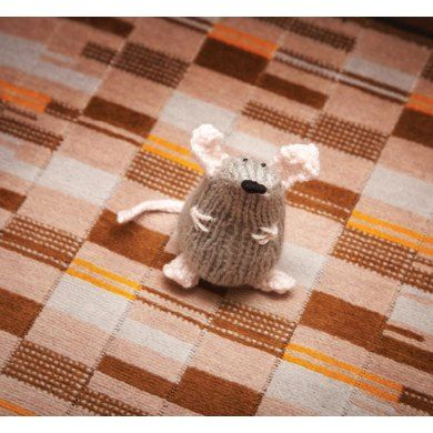 Knitted this pattern? Upload a picture to PLANET WHODUNNKNIT and show it off to the world.Toerag the tube mouse: sooty-furred with underground filth, hard of hearing due to endless ear-shattering train thunder and reluctant to pause for pictures, but proof that even in London's dusty undercarriage there's something to smile about.See more about the kooky little Stitch London knitting book at www.knitthepigeon.comAnd find out more about the author at www.whodunnknit.com