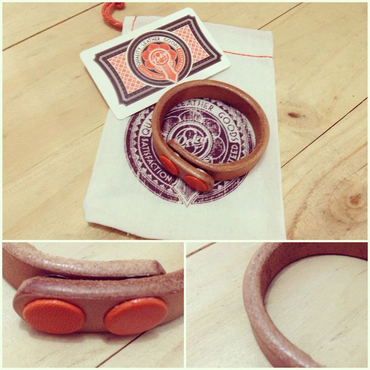 Thick Vegetable Tanned Leather bracelet, with orange goat leather covered snap button..