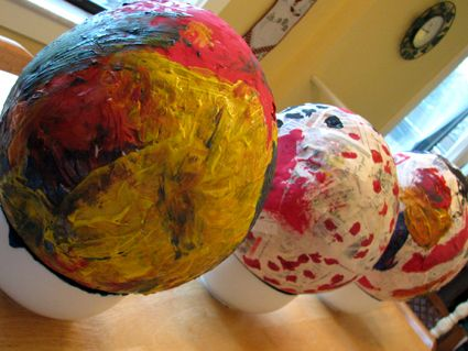 I've made dinosaur papier mache eggs twice with my summer school classes.  It's a fun week-long project.
