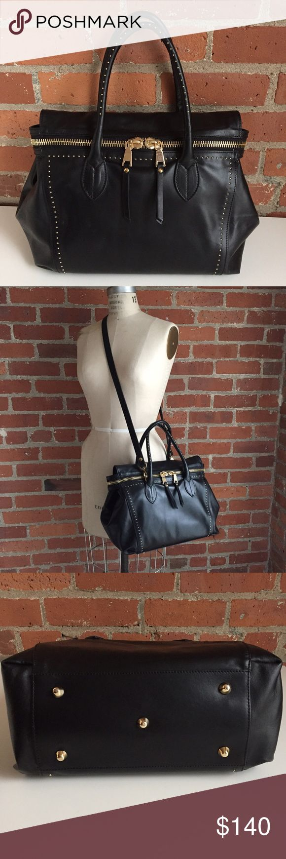 Black Leather Moto Satchel Gorgeous soft leather with micro stud detailing on the front and handles. Like brand new, I am super careful with my bags! No marks or stains, and I have a nonsmoking, pet-free home. The oversized gold zipper extends out to each side so you can open the bag wide. The zipper ends can snap to the back of the bag, or you can leave them loose. The long strap is detachable. This bag is surprisingly lightweight,  and you just want to hug it because the leather is so soft…