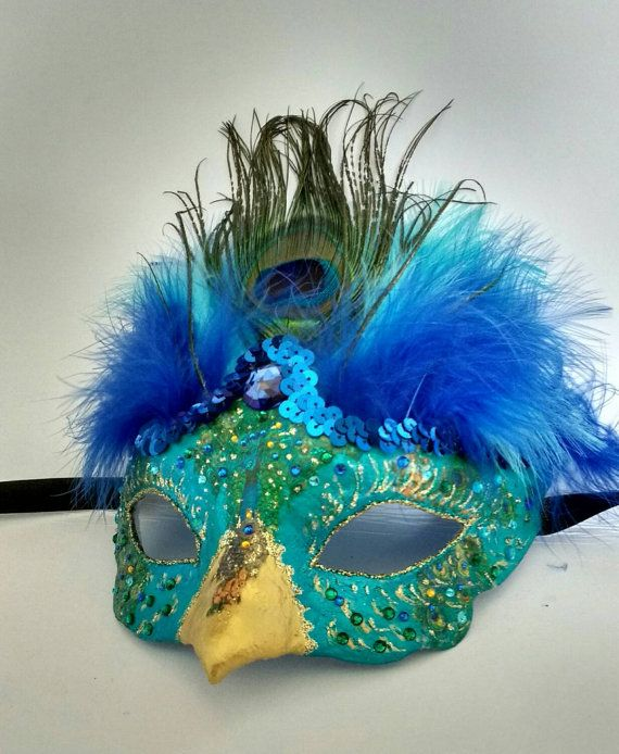 Beautiful peacock mask  Handmade peacock mask with gold beak and blue feathers Made with plaster bandage over a plastic base and then hand