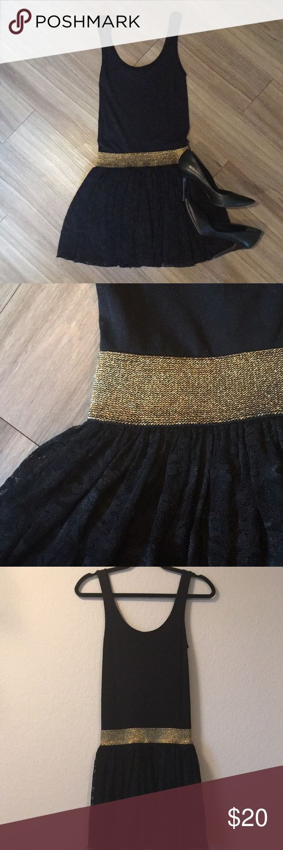 Bebe Drop Waist Dress Black dress, fitted jersey tank style top with gold stretch belt and full layered lace skirt. Cute and flirty, great for a night out dancing! bebe Dresses Mini