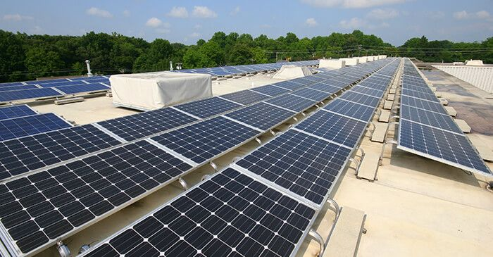 Tired Of Paying High Energy Costs On Your Building Attention Commercial Building Owners Take Advantage Of The Federal Solar Panel Cost Solar Solar Projects