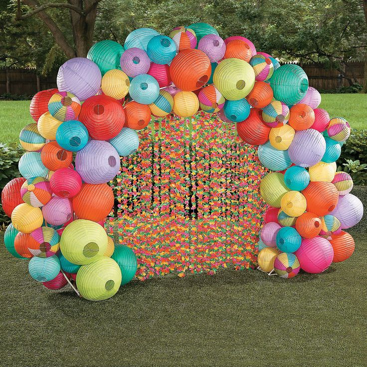 Luau Lantern Archway Idea   Luau like never before with this colorful addition to your DIY party decorations! Makes a great party entryway or spot for luau photos and party selfies. #party