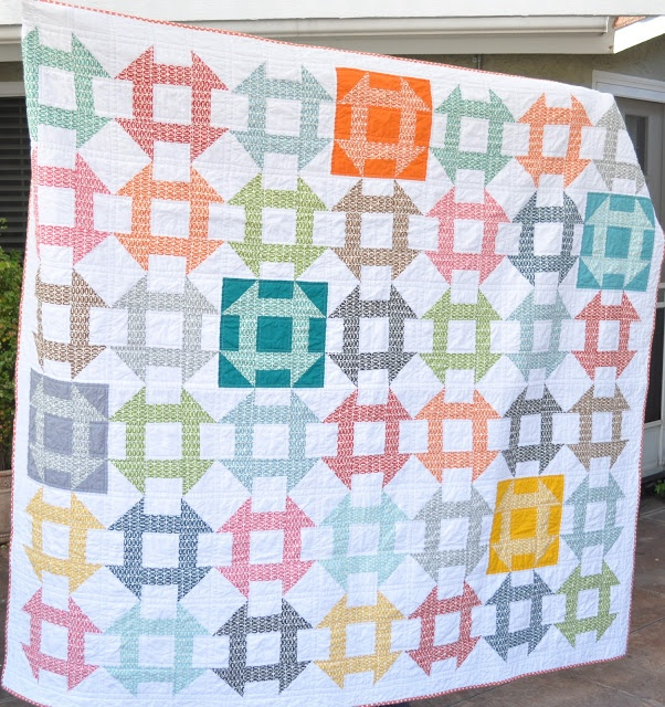 Pezzy Churn Dash Quilt (using a layer cake of Pezzy Prints, a few coordinating solids, and White Kona yardage) | by Diane Stanley of Random Thoughts
