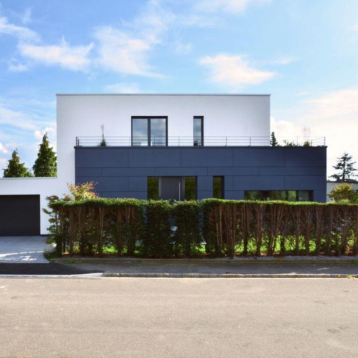 Einfamilienhaus im Bauhausstil - Plusenergiehaus | p - (Holzhaus mit Putzfassade und Faserzementplatten)