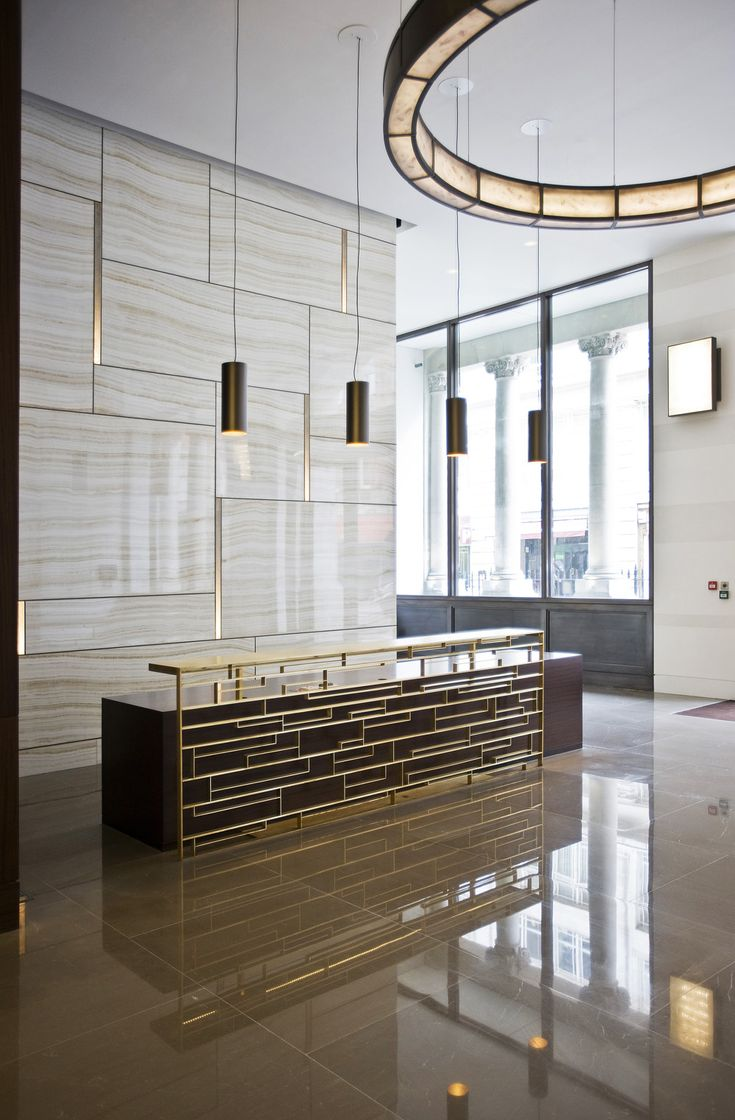 reception desk metal brass - Google Search