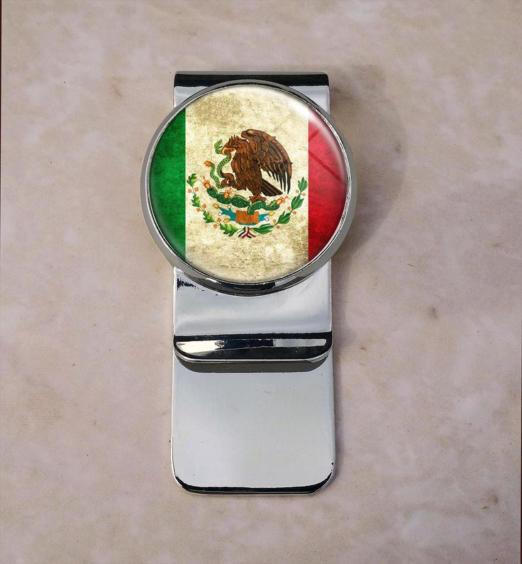 Bandera de Mexico Money Clip. Welcome Up for sale is this beautiful money clip. The metal portion is composed of brass and weighs approximately 17 grams.Central Round Image: 25 mm in diameter, (approximately 1 inch). The rectangular clip portion is 55 mm in length and 22 mm wide The setting encompasses a high resolution image that has been printed with a printer specifically made for printing high resolution images. The image is sealed with a high quality resin to ensure vibrancy and...