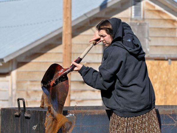 The Hutterites Amanda Hofer stirring the soap mix.