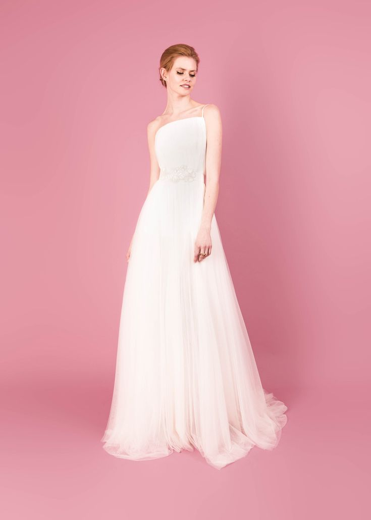 Modern wedding dress for the contemporary bride. Octavia dress. Backless tulle gown with side slit.