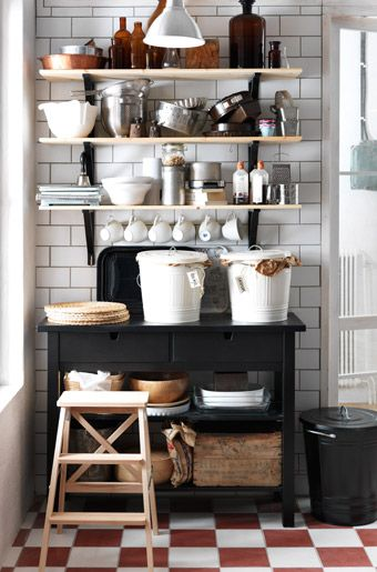 black  white  wood :: metro tiles, vintage style floors, open shelves, black kitchen island (Förhöja I think) - all by Ikea