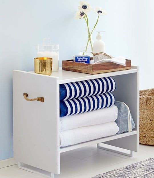 DIY white painted bathroom storage stool with rope handles made from IKEA Rast nightstand