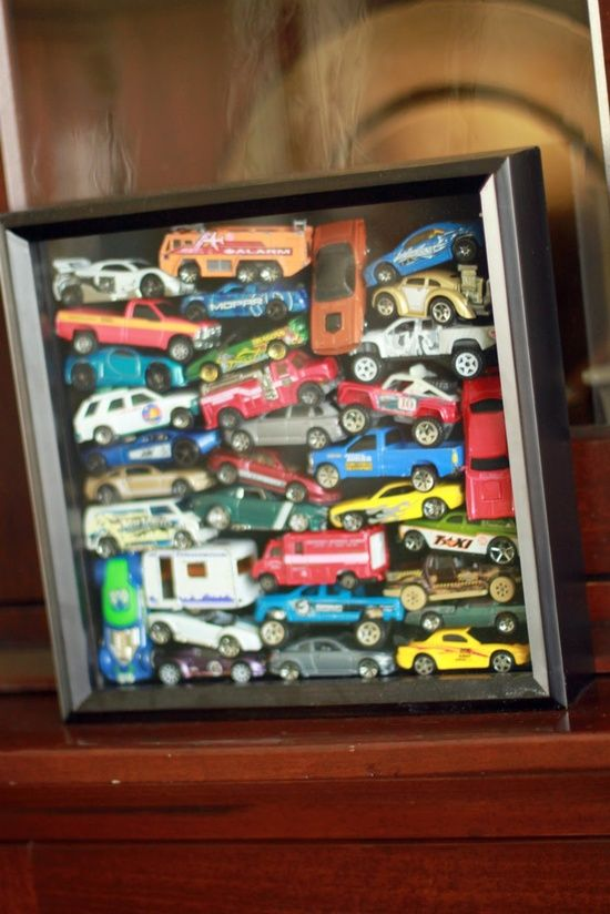 Got a kid (or a husband) who can't part with a collection of Matchbox cars? Use them as art by displaying them in a shadow box on the wall! Great idea!