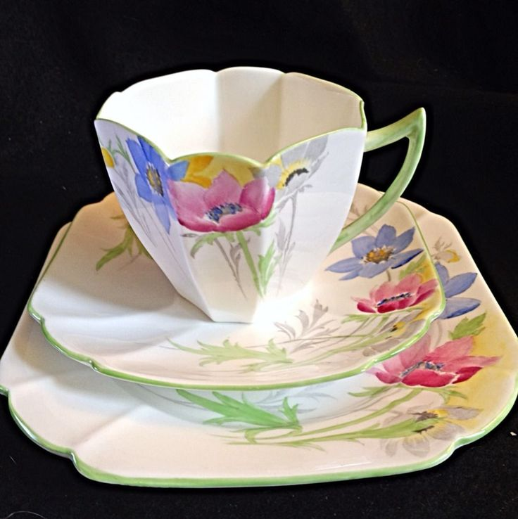 """Beautiful sprightly sea anemone flowers adorned this shelley Queen Anne trio. In mint condition. Pattern #12067 - Anemone. Dessert Plate is 6 1/4"""" Square across. 1 TALL TEA CUP, 1 SAUCER & 1 SQUARE PLATE. 